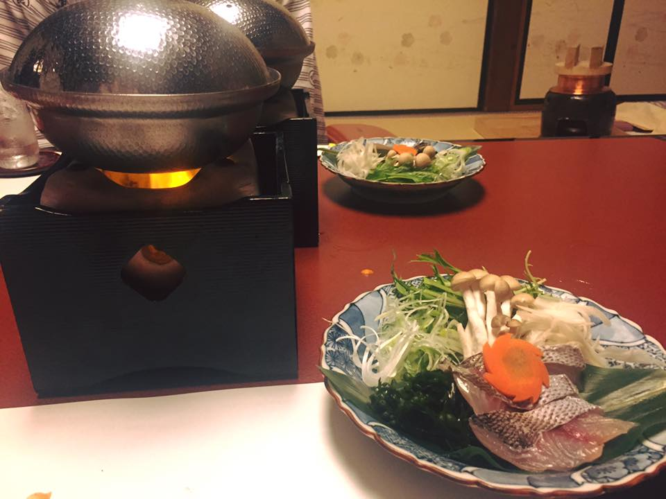 A hot pot with seasonal fish, vegetables, and meat.