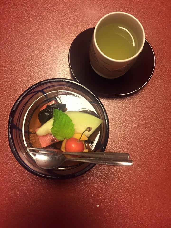 Fresh, seasonal fruit on a sweet gelatin and green tea.