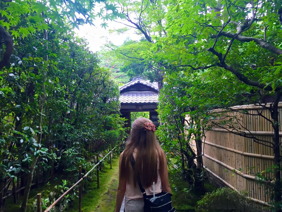 Woman standing on a path surrounded by greenery (Koto-in Temple in Kyoto)
