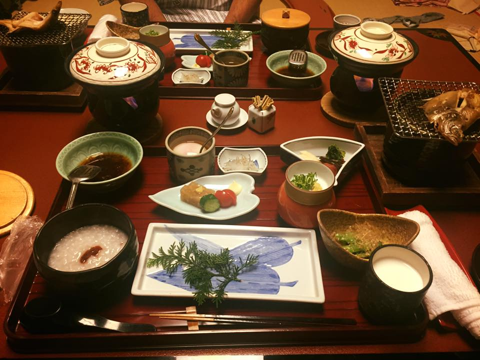Grilled fish and a variety of sides at a Kaiseki meal