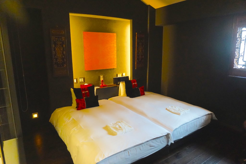 Two twin beds at Hotel Mume in Kyoto, Japan