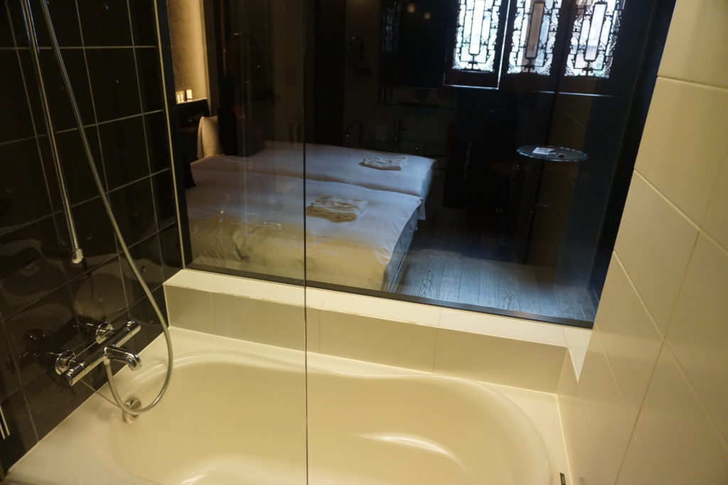 Bathroom (shower and tub) at Hotel Mume in Kyoto, Japan