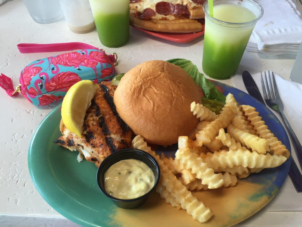 Blackened grouper sandwich with fries from Daiquiri Deck in Sarasota.
