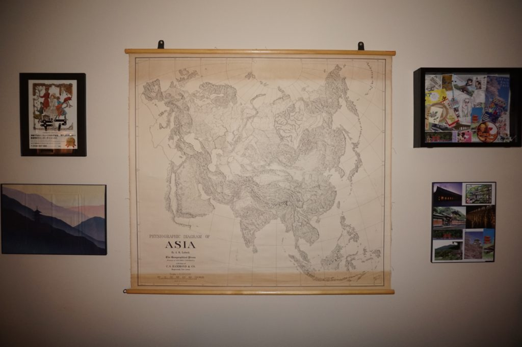Gallery Wall - Travel Decor, photos framed on left and right, large map of Asia in the center