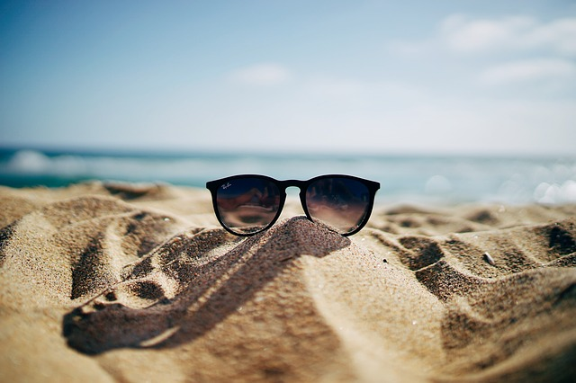 Sunglasses on the sand - Beach checklist and tips