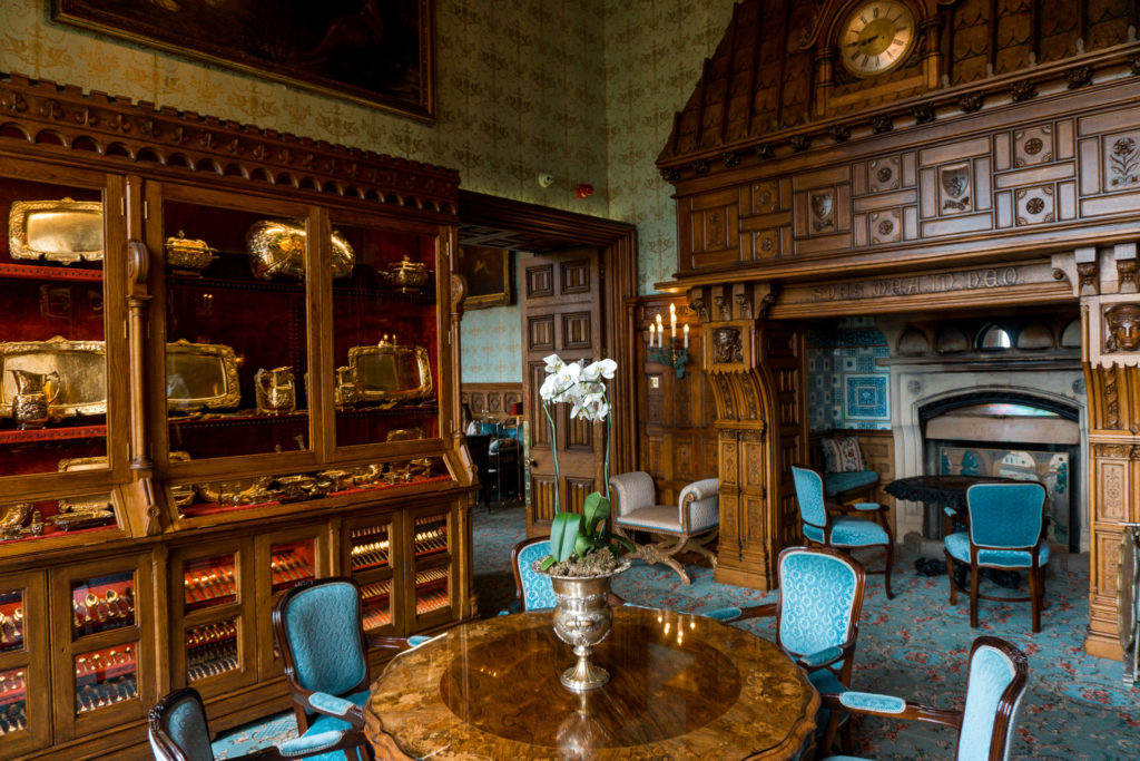 A sitting area in Ashford Castle with light blue chairs and wooden decor.