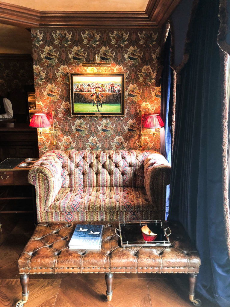 A decorative couch inside the billiards room at Ashford Castle