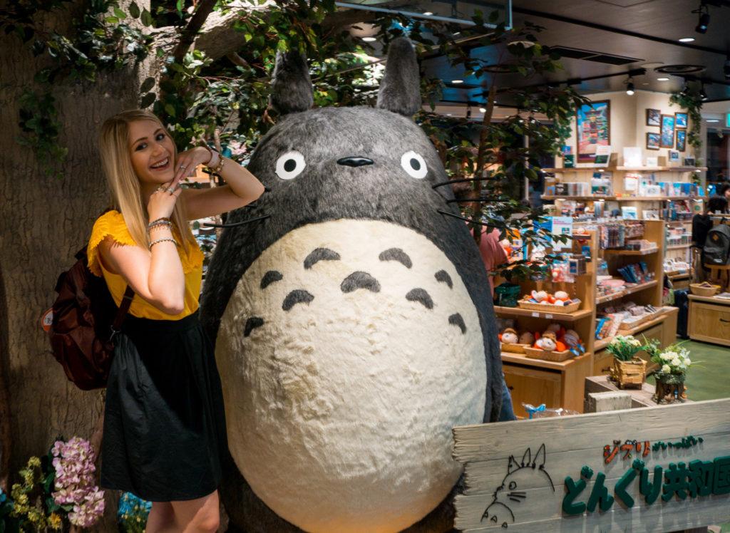 Woman posing with a statue of Totoro - Fukuoka, Japan