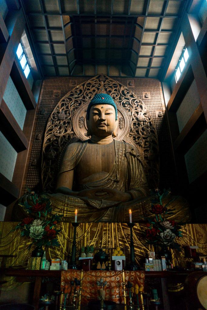 Large scale wooden Buddha at Tochoji Temple in Fukuoka, Japan