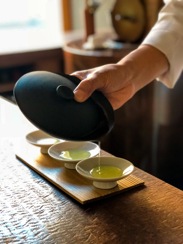 Hand pouring green tea at YOROZU - Fukuoka