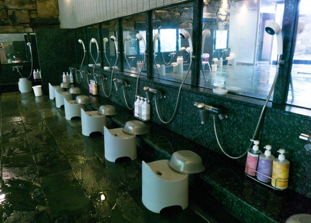 Shower Room at the Public Hot Spring Onsen at Nishimuraya Hotel Shogetsutei - Kinosaki Onsen ryokan