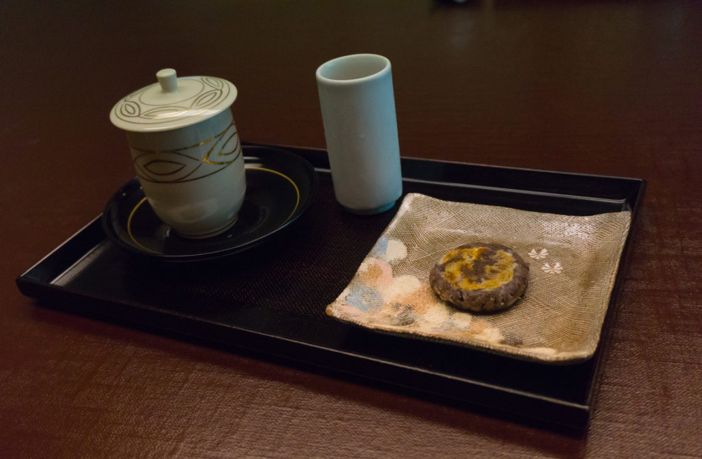 Cold tea and Japanese sweet.