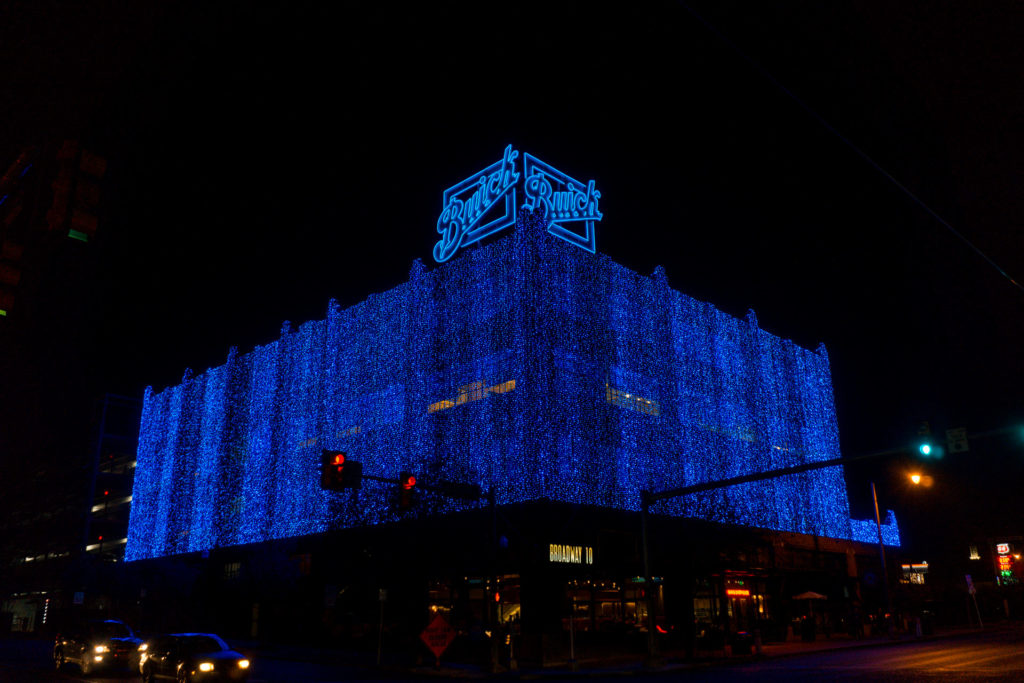 Blue holiday lights on brick building in Automobile Alley OKC