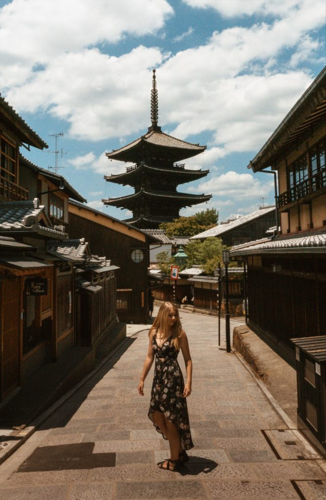Woman standing in historic street in Kyoto, Japan (Sannezaka Ninezaka)