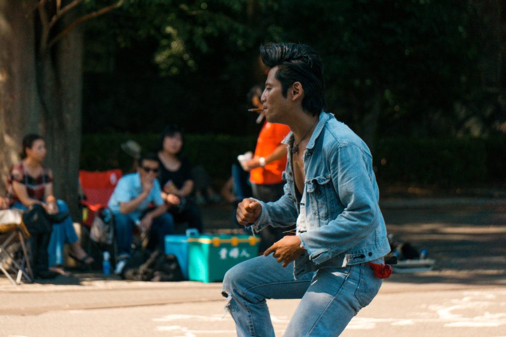 Man dressed in denim dancing (rockabilly dancers Tokyo)