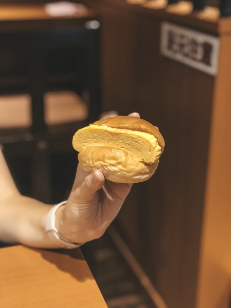 A sweet bun with rolled egg omelet at Nishiki Market