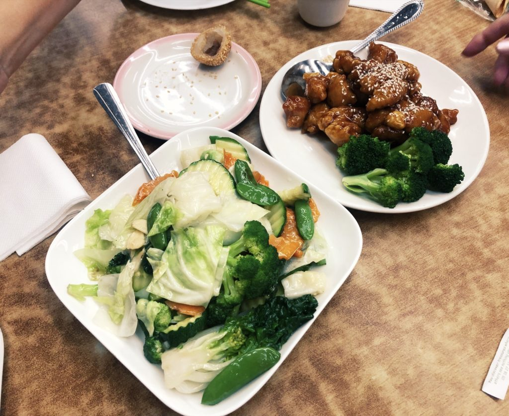Steamed veggies, steamed sesame ball, and sesame chicken from Grant Place Restaurant in Chinatown San Francisco.