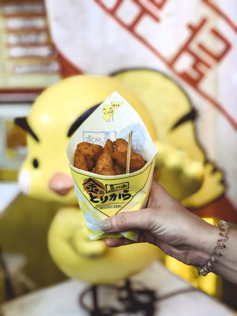 Pieces of fried chicken Dotonbori street food in Osaka Japan