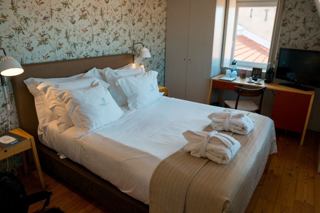 Bed at Lisboa Carmo Hotel perfect for a place to stay for your Lisbon itinerary.