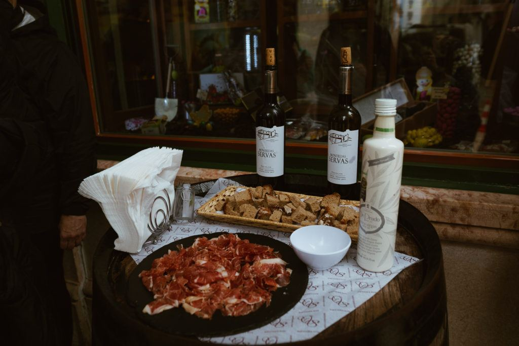 Sampling of bread, cheese,  cured ham, and wine from the Taste of Lisboa food tour
