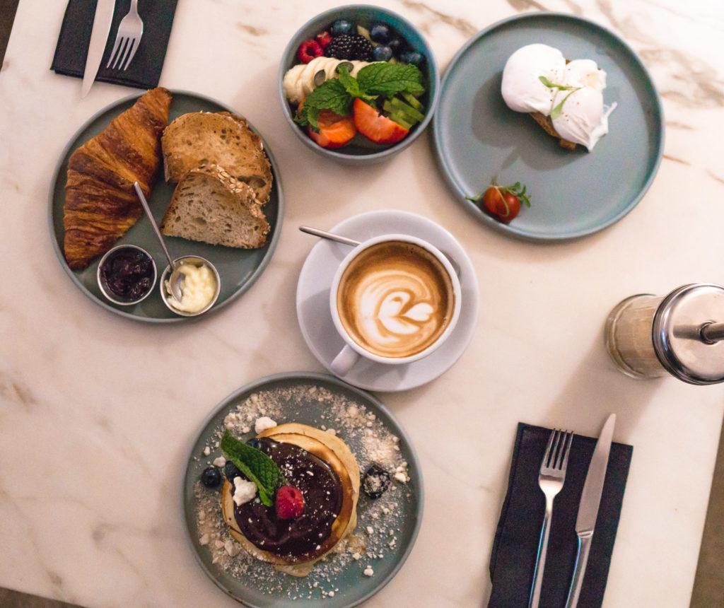 Flatlay shot of breakfast items from Dear Breakfast in Lisbon, Portugal