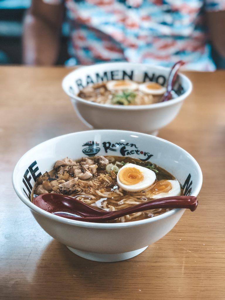 Two bowls of freshly prepared ramen.