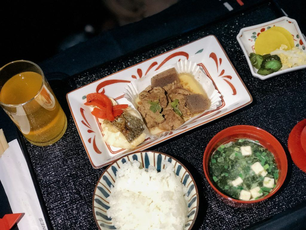 Salt-grilled sea bass entree with the Japanese style meal on Japan Airlines business class