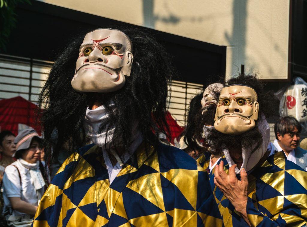 Men wearing masks at Gion Matsuri - Kyoto