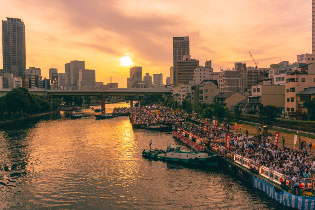 Sunset on the river for Tenjin Matsuri in Osaka.