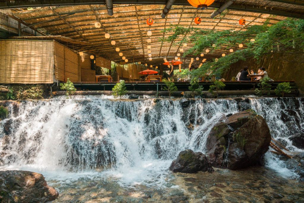 Waterfall in front of seating area at Hirobun nagashi somen