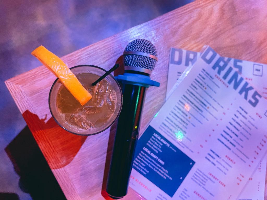 Cocktail, microphone and menu at Big Box Karaoke in Fayetteville, Arkansas