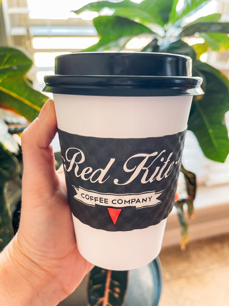 White and black coffee to-go coffee cup from Red Kite Coffee Company in Springdale, Arkansas