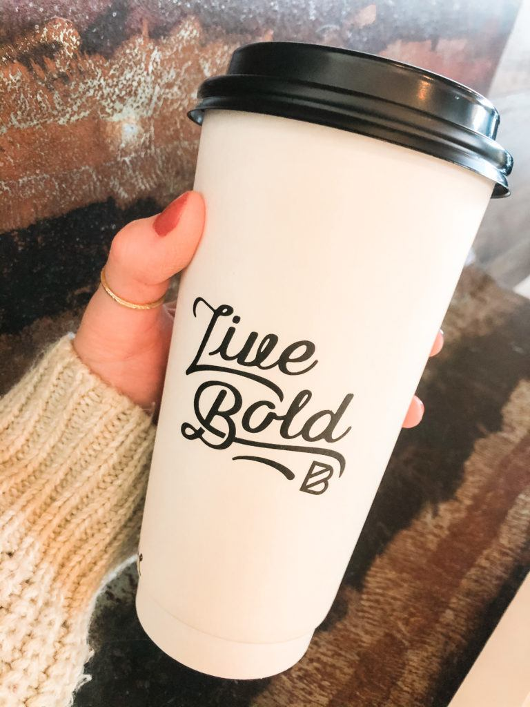 """to-go coffee cup that says """"live bold"""" from Bolder Coffee shop in Northwest Arkansas"""