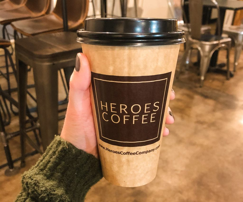 to-go coffee cup from Heroes Coffee in Bentonville, Arkansas