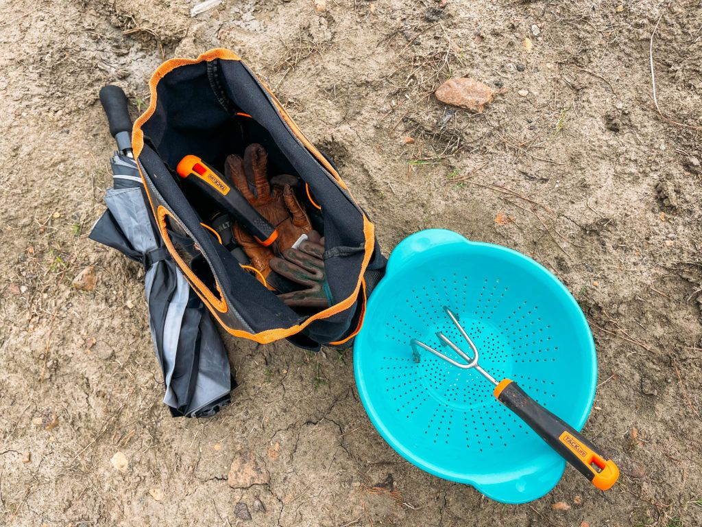 Various garden tools and a blue strainer used for digging for diamonds at Crater of Diamonds State Park in Arkansas