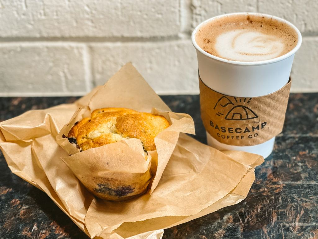 Muffin and coffee with latte art from Basecamp Coffee in Fayetteville, Arkansas