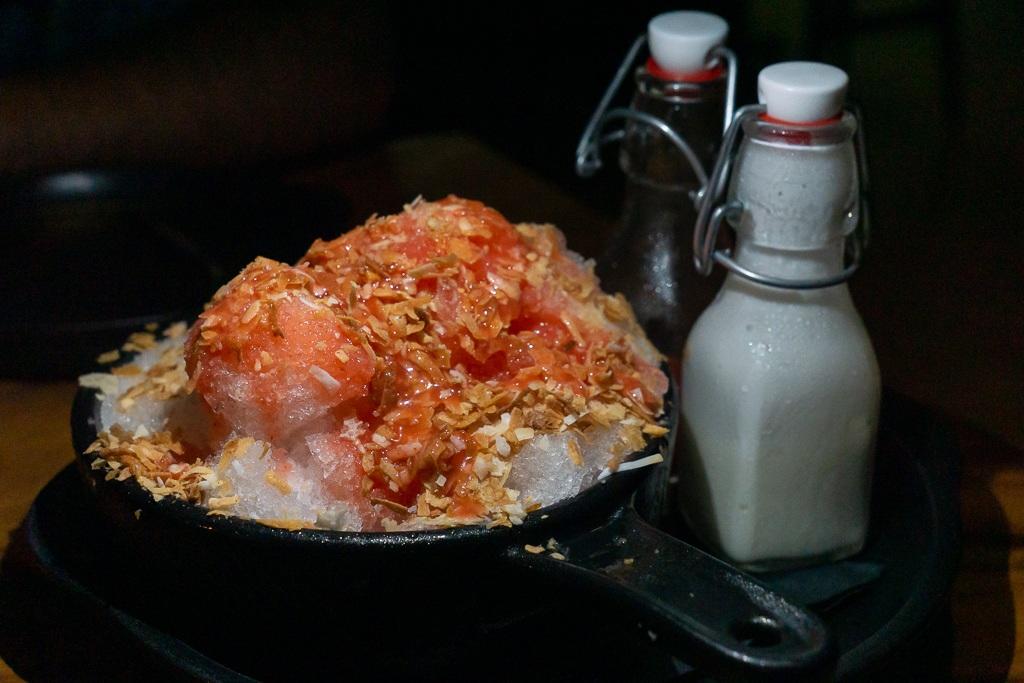 Kakigori (Japanese shave ice) with strawberry puree, coconut milk, and coconut flakes from Kojo in Sarasota, Florida