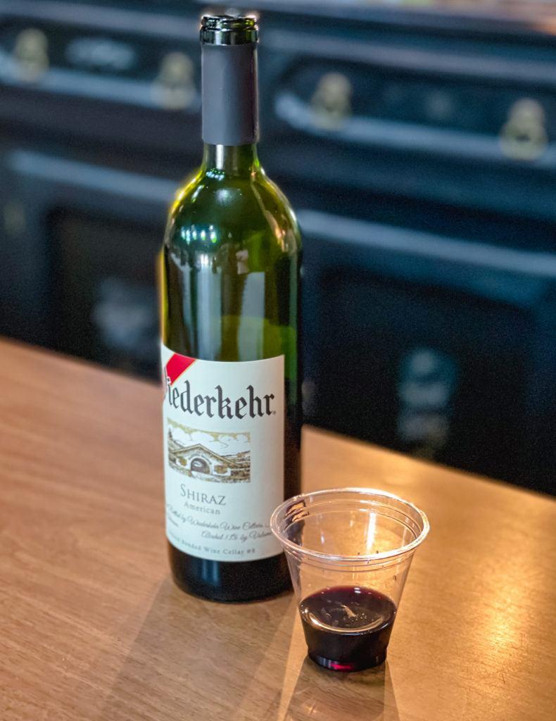 Bottle of red wine and tasting glass from Wiederkehr Wine Cellars in Altus, Arkansas
