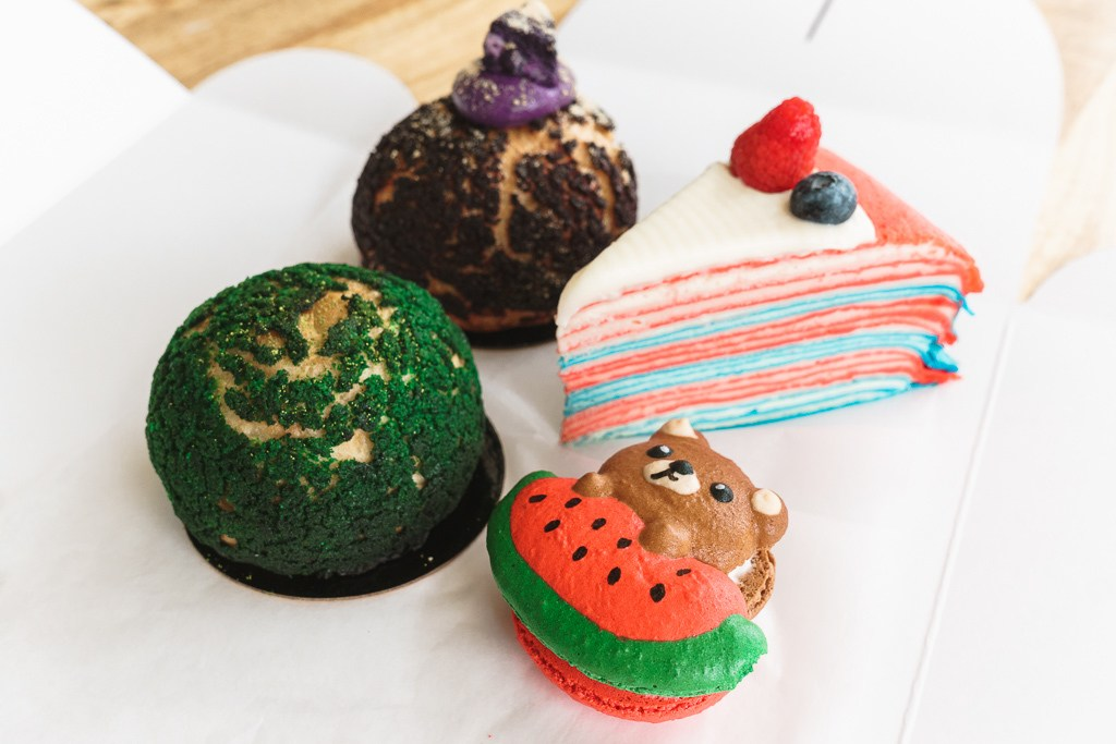 ube and matcha creme puffs, vanilla crepe cake, and macaron bakery items from Light on the Sugar in Orlando - best desserts in Orlando